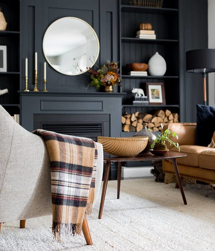 black fireplace surrounding with brown furniture and decor accents