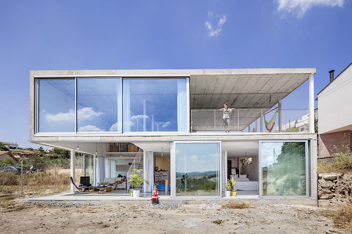 Garage and studio sit on the upper level of the house while the living areas occupy the lower floor