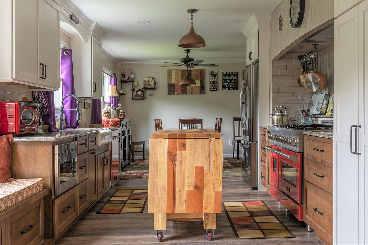 Gorgeous custom wooden island on wheels is just right for this lovely modern eclectic kitchen