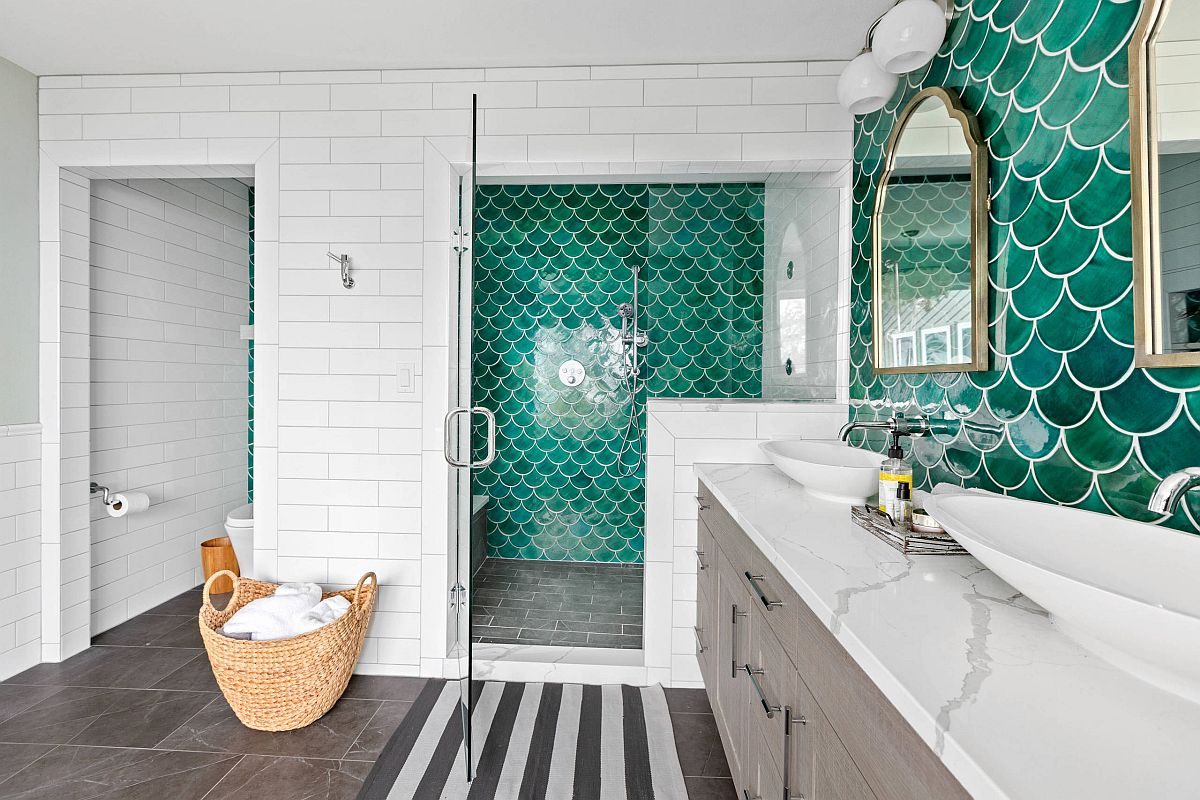 Gorgeous green tiles of the accent wall add to the beach style of this bathroom