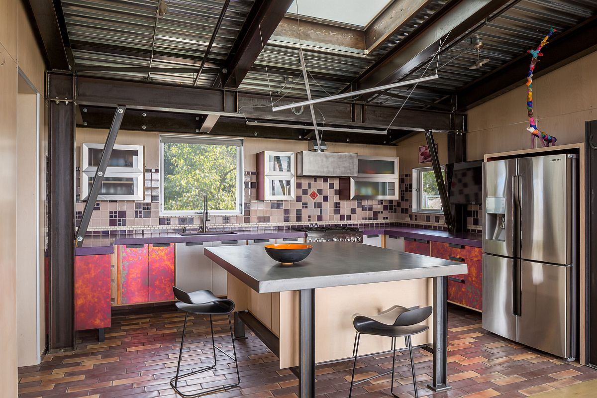 Ingenious steel frame holds this small floating island in wood inside this spacious eclectic kitchen