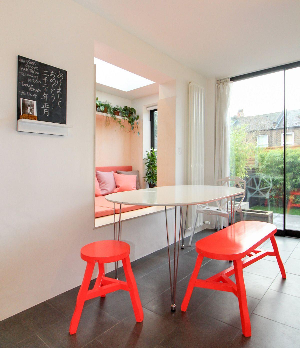 Innovative modern beakfast nook with splashes of red all around