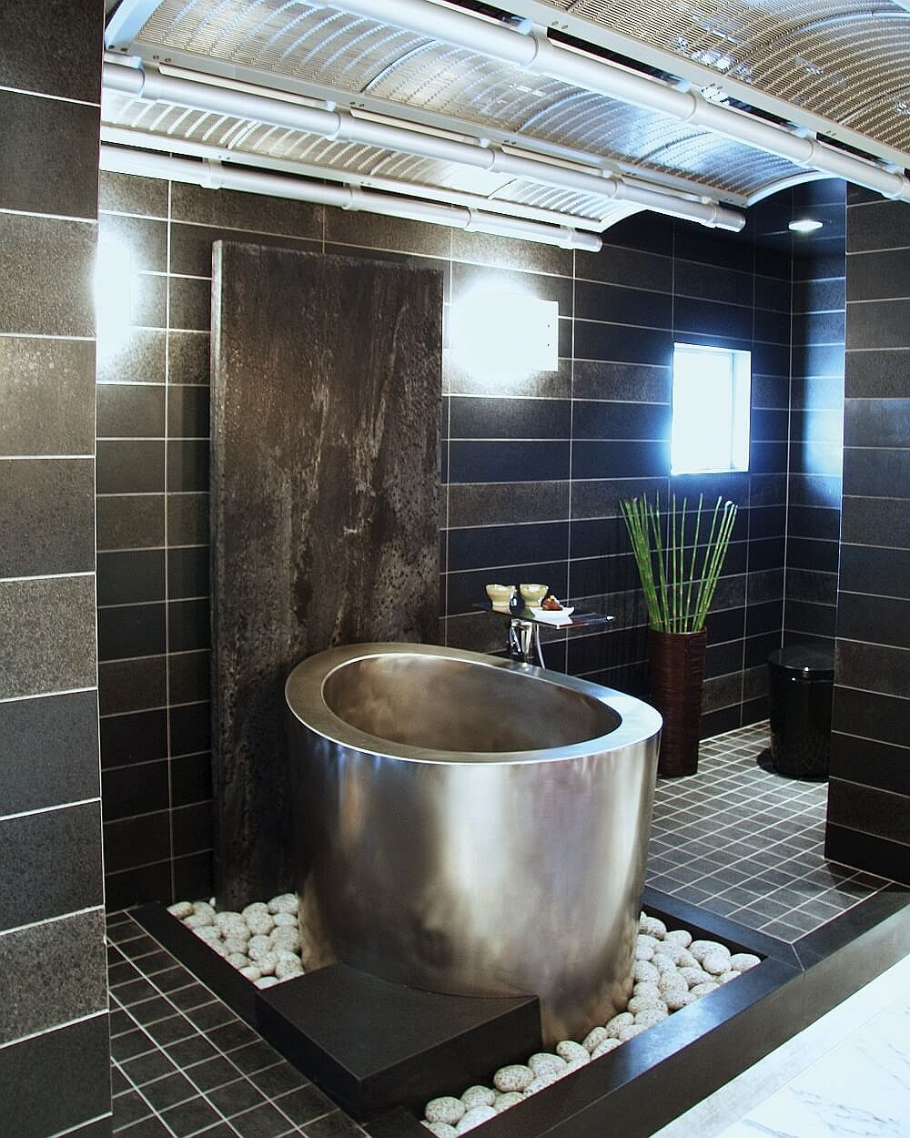 Japanese soaking tub in stainless steel is just perfect for the modern, spa-styled bathroom