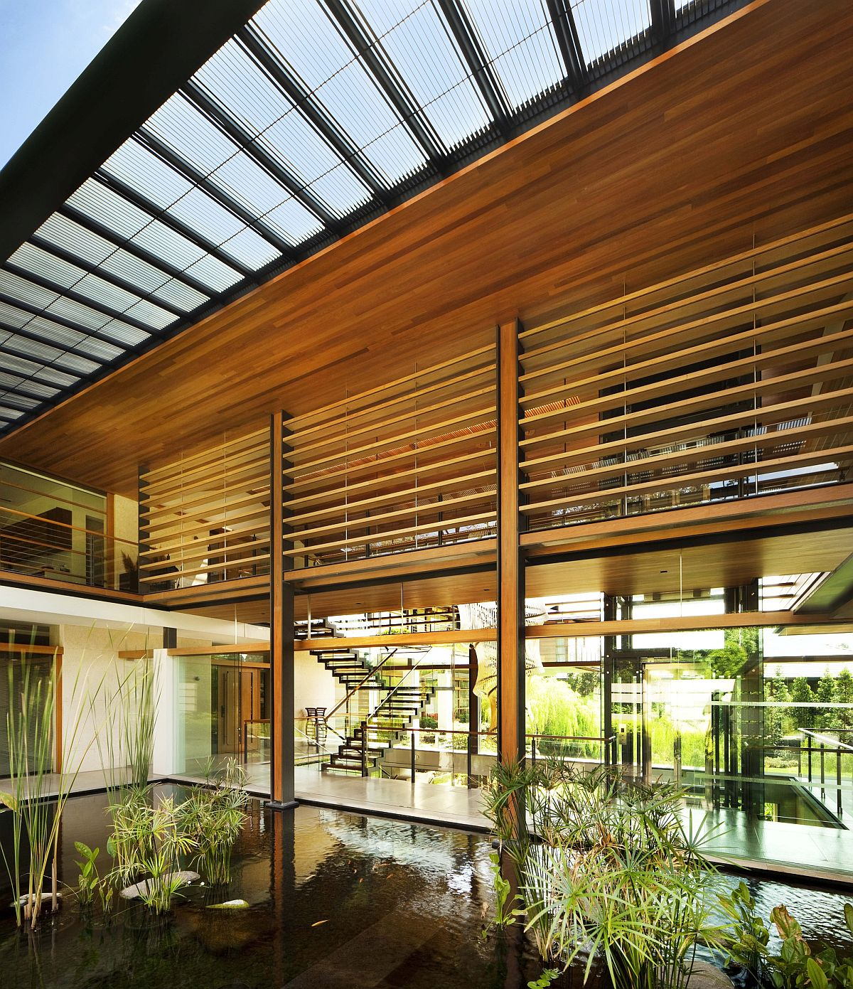 Landscaped ponds and courtyards combine nature with modernity inside the home