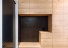 Larch-and-pine-wood-cabinets-create-a-perfect-backdrop-in-the-kitchen-and-offer-ample-storage-space-33418-217x155
