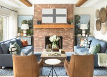 Lovely-brick-fireplace-is-the-perfect-focal-point-for-this-small-farmhouse-style-living-space-97914-217x155