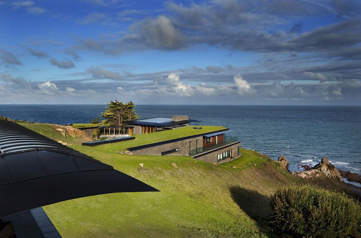 Lovely green roof blends the home seamlessly into the coastal landscape