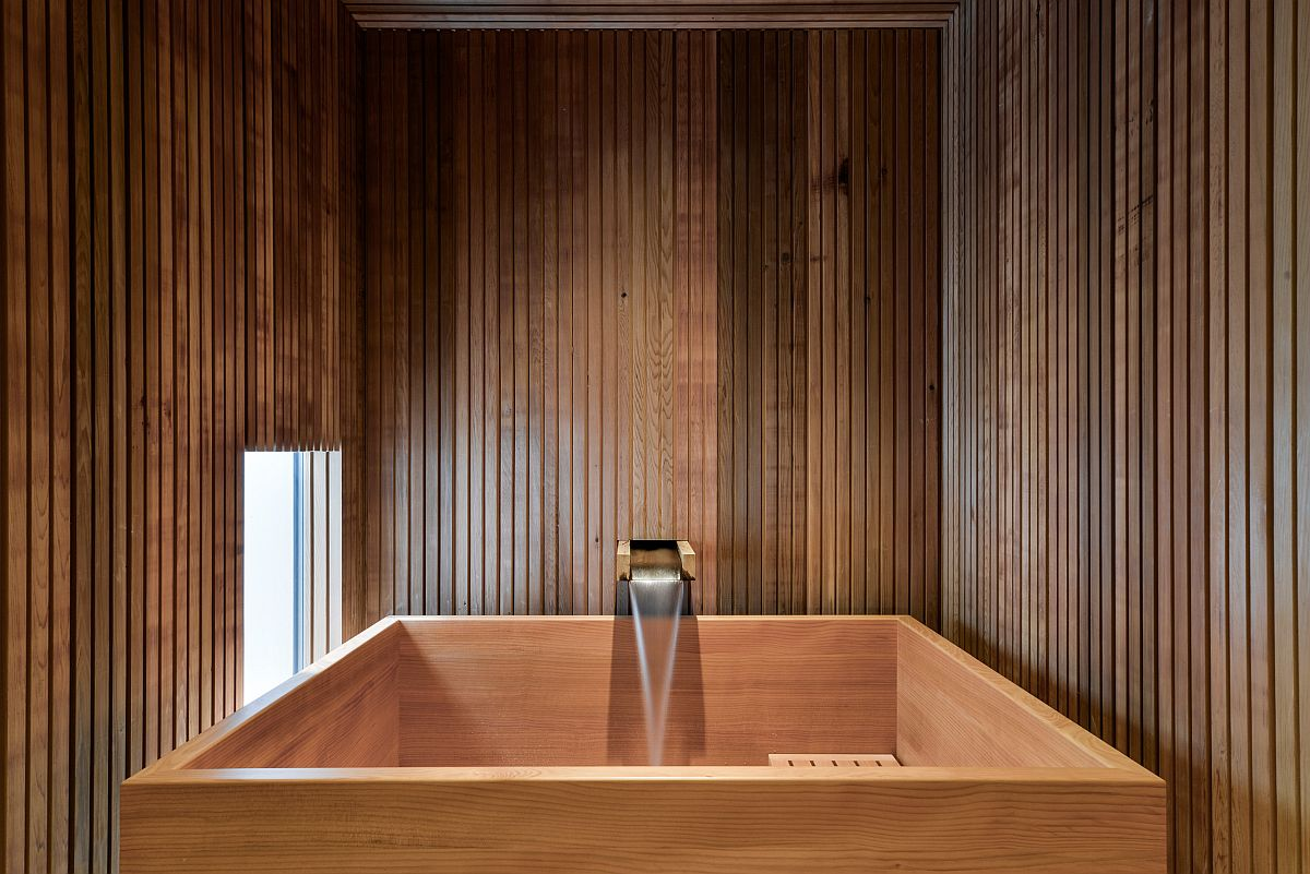 Modern Japanese soaking tub in wood is perfect for the small bathroom