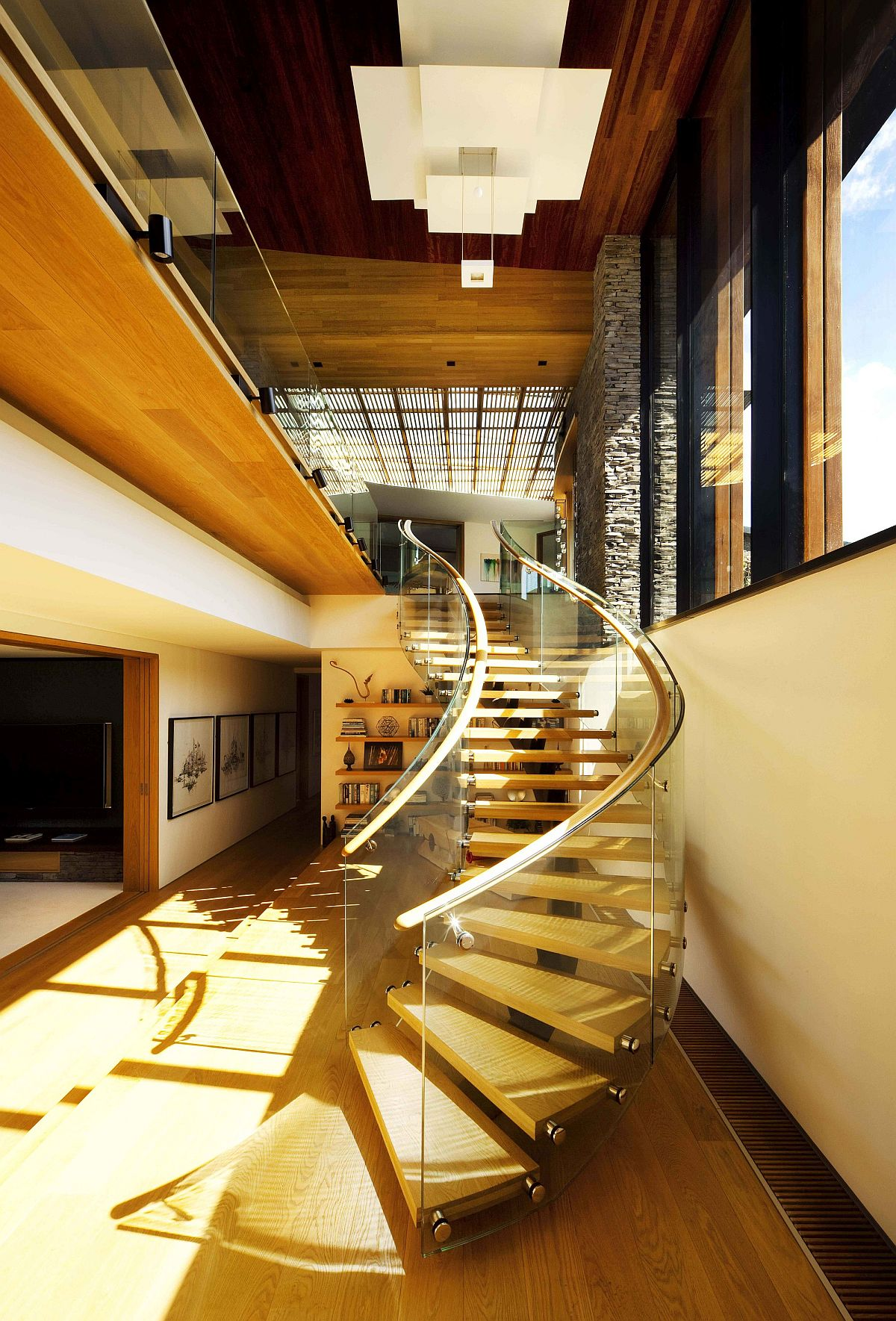 Modern curvy staircase leads way to the upper level of the home