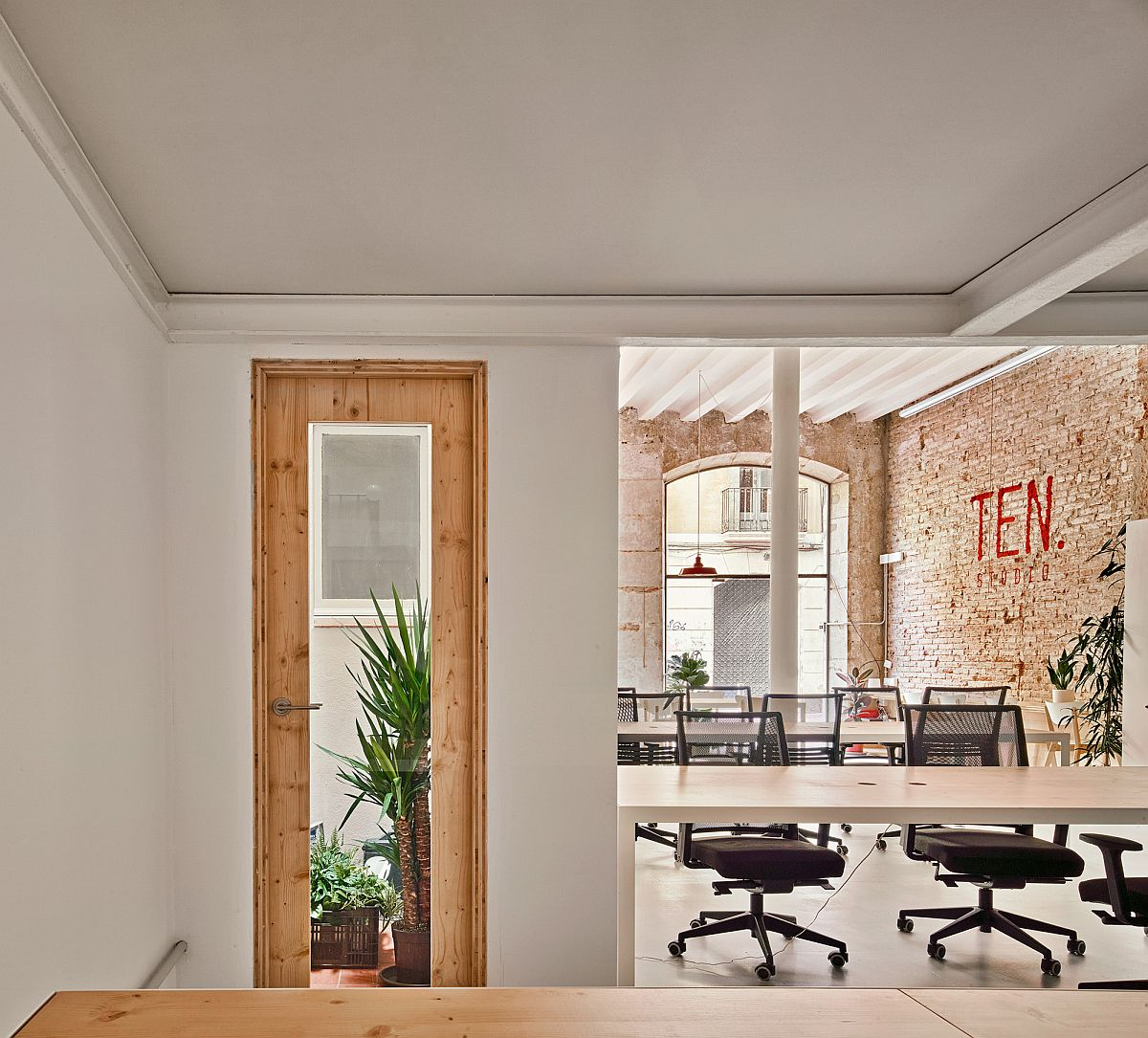 Natural light and revamped interior create a lovely office in Spain