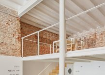 New-mezzanine-level-added-to-the-interior-provides-additional-workspace-inside-the-tranformed-art-shop-22327-217x155