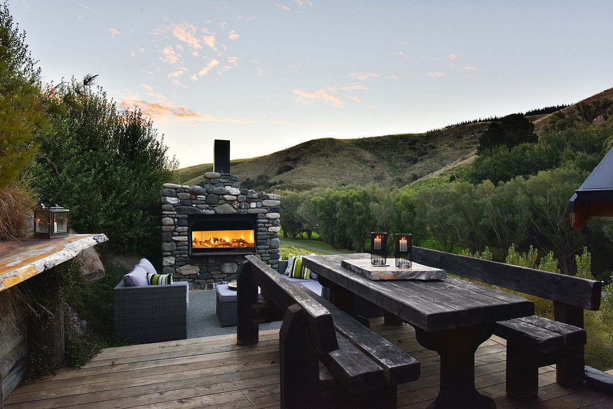 Outdoor sone fireplace, hangout and dining area allows you to spend time out with friends and family