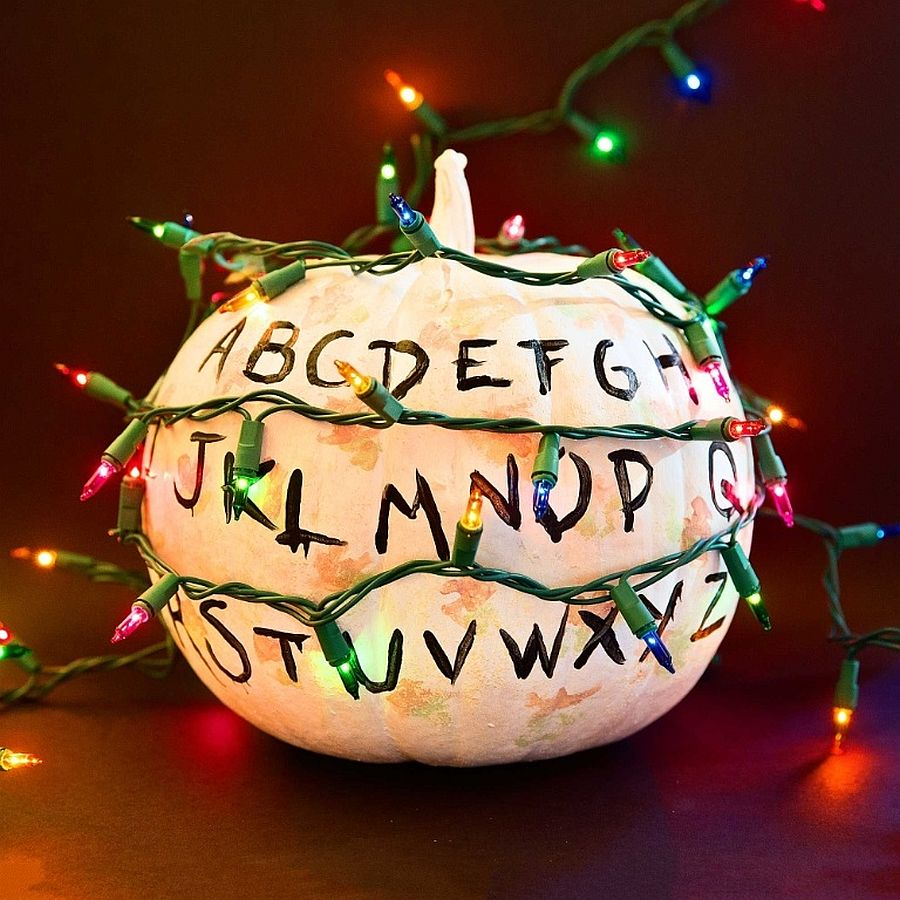 Painted pumpkin DIY with alphabets and festive lighting works well during Halloween and beyond
