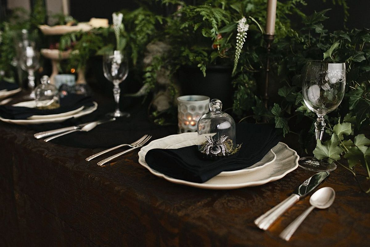 Picture-perfect tablescape for dark Halloween dinner party is an absolute showstopper!