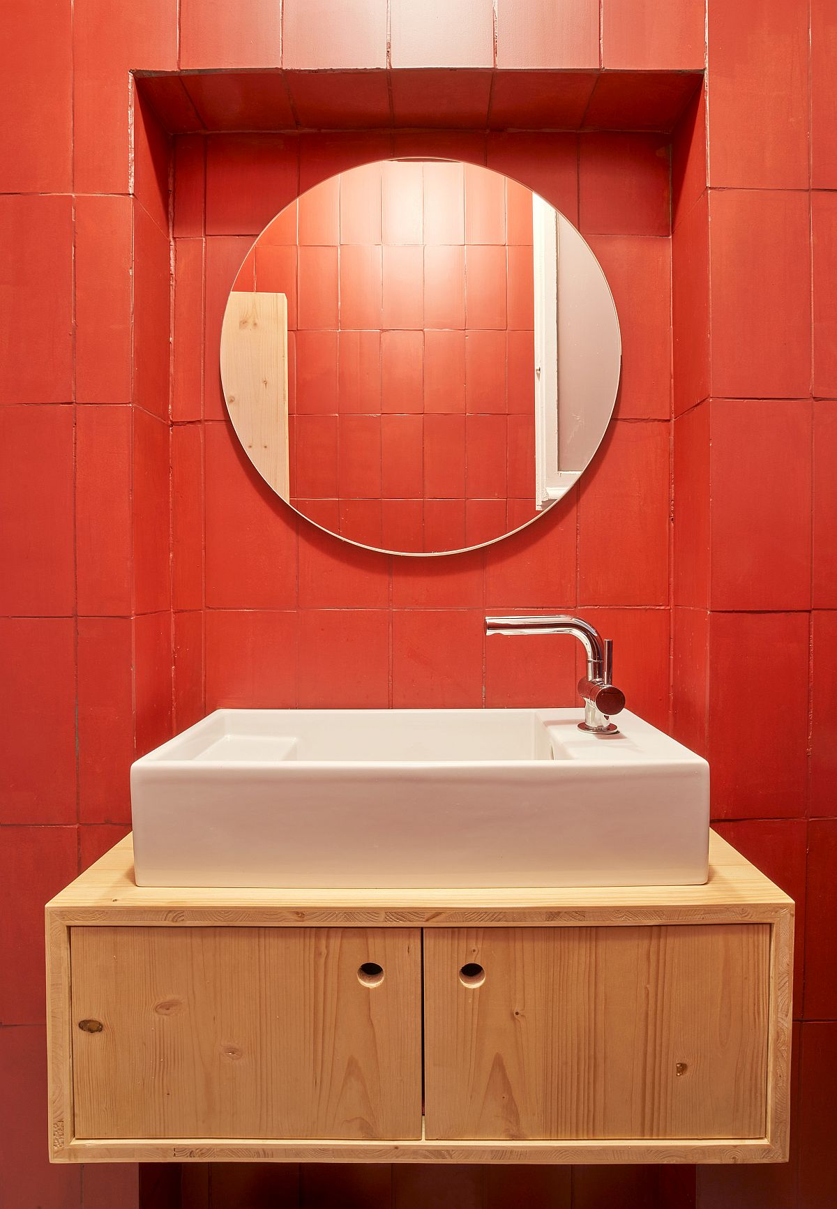 Red bathroom with a smart floating wooden vanity