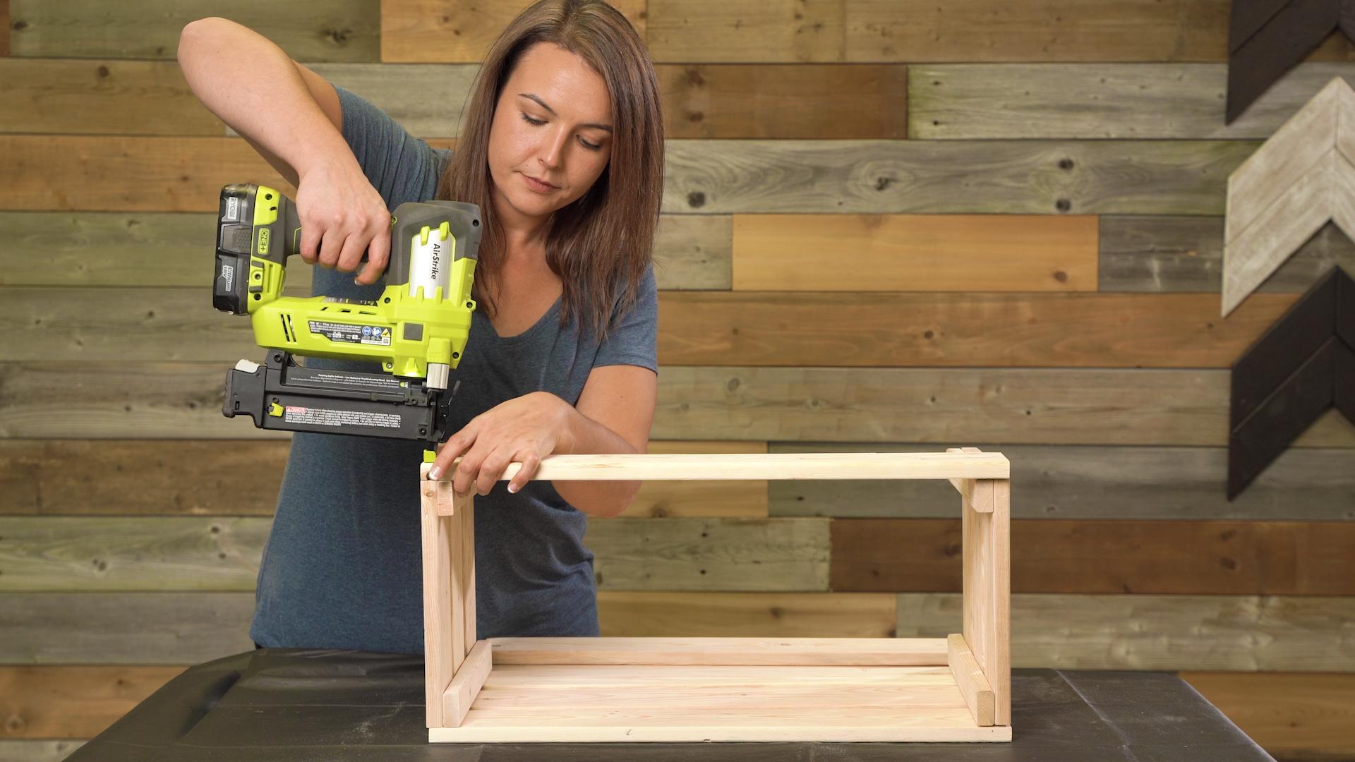 nail gun connects wooden box pieces
