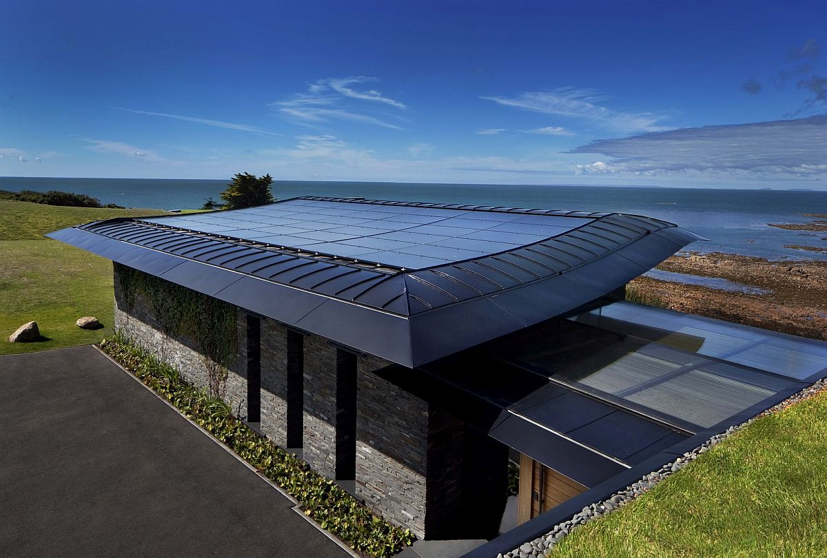Slate and natural stone shape this stunning contemporary coastal home that is also eco-freindly