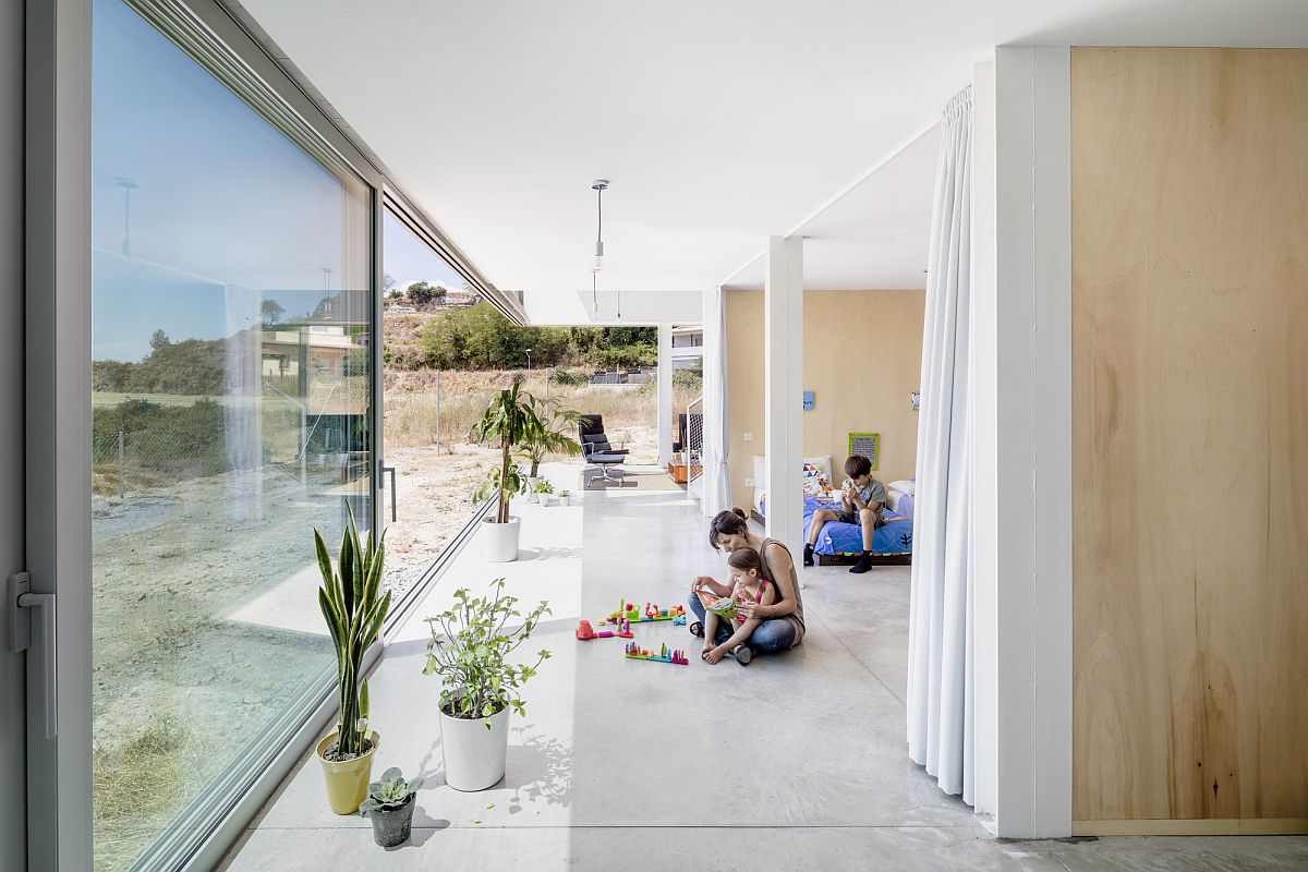 Sliding glass doors connect the lower level living areas and bedroom with the outdoors