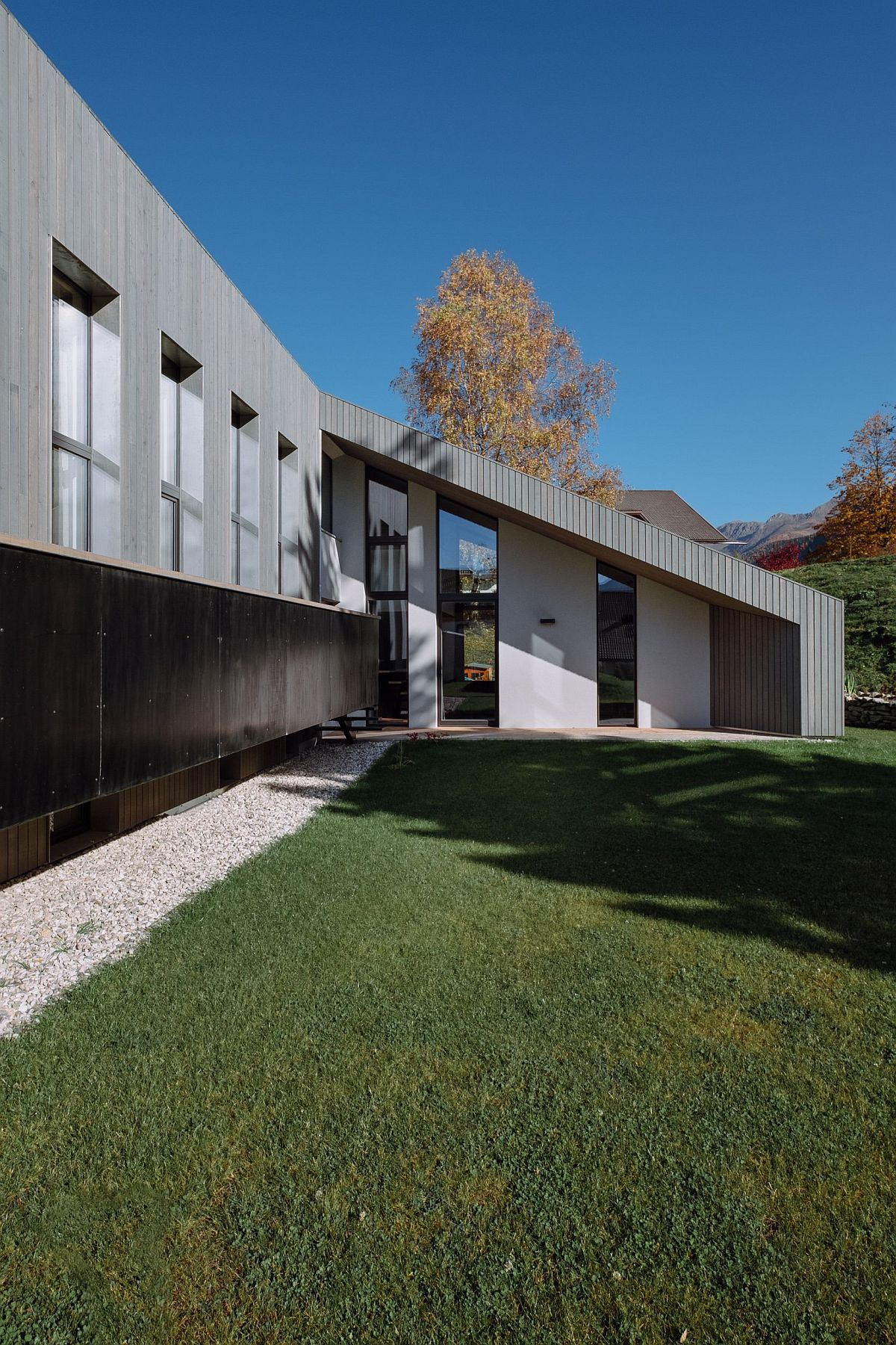 Sloped roofs and custom exterior give the home an identity of its own