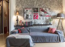 Small-eclectic-living-room-with-a-textured-wall-in-the-backdrop-and-a-small-couch-in-gray-59800-217x155
