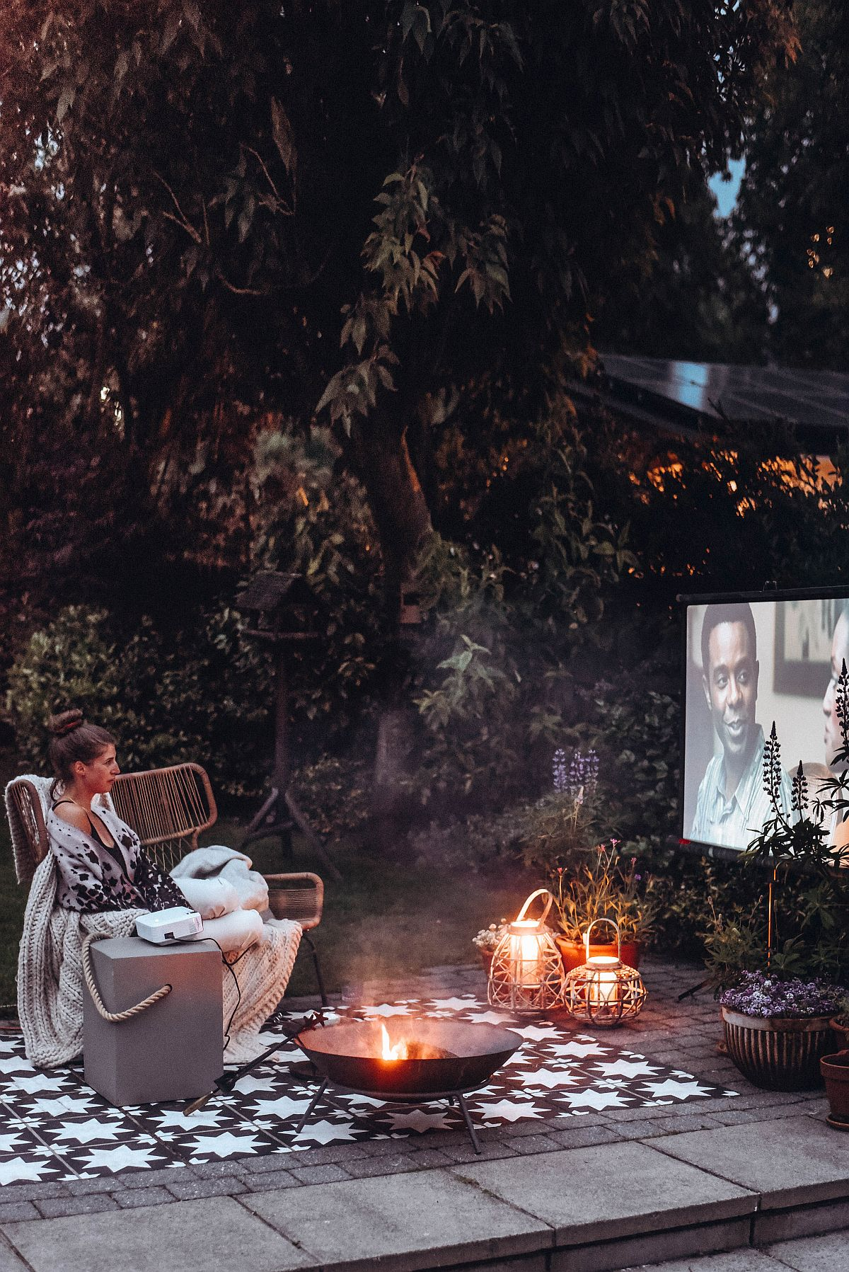 Small firepit turns the outdoor theater into a cozier hangout