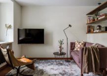 Tiny-living-room-with-small-sofa-and-TV-in-the-corner-69366-217x155