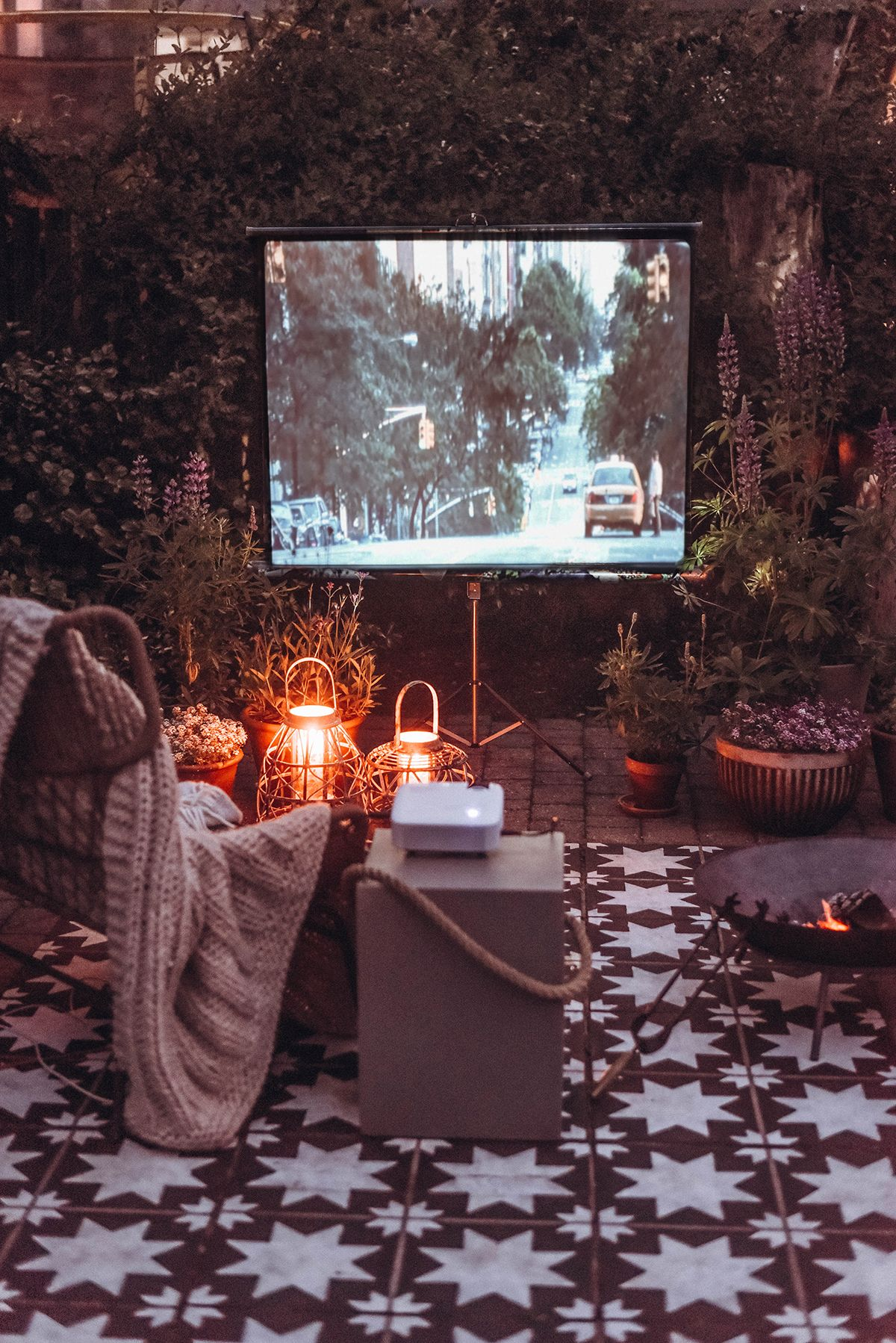 Vintage screen and projector shape this fab outdoor cinema