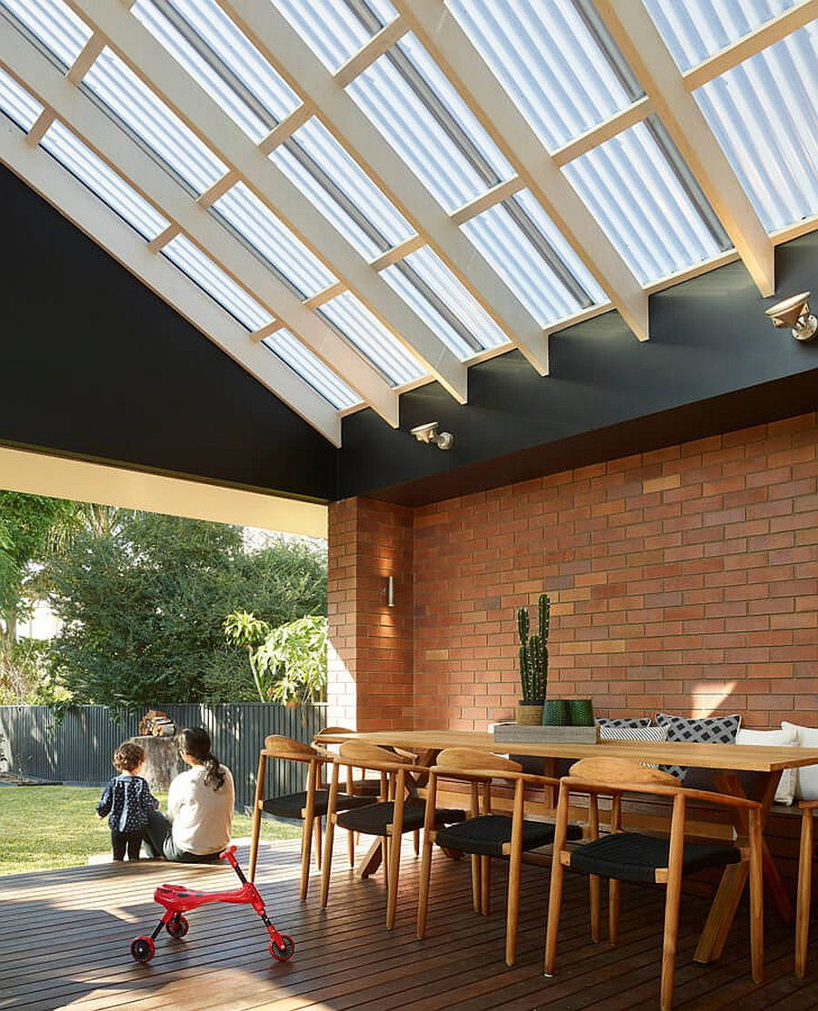 Wood and brick extension of the classic home contains the new kitchen, dining area and living room