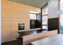 Wood-and-concrete-modern-kitchen-and-dining-area-with-polished-stone-floors-79681-217x155