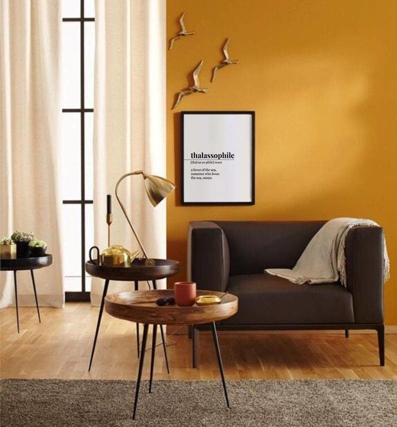 orange living room with brown furniture and wall art