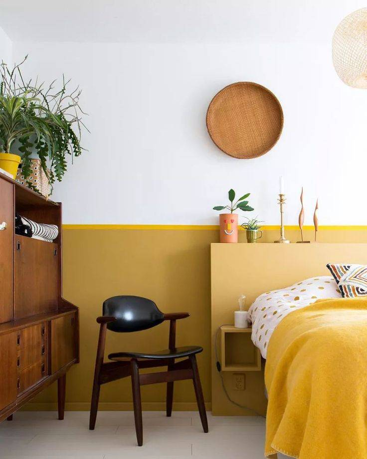 mustard yellow color block bedroom with brown accents