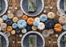 an array of painted pumpkins as a thanksgiving centerpiece