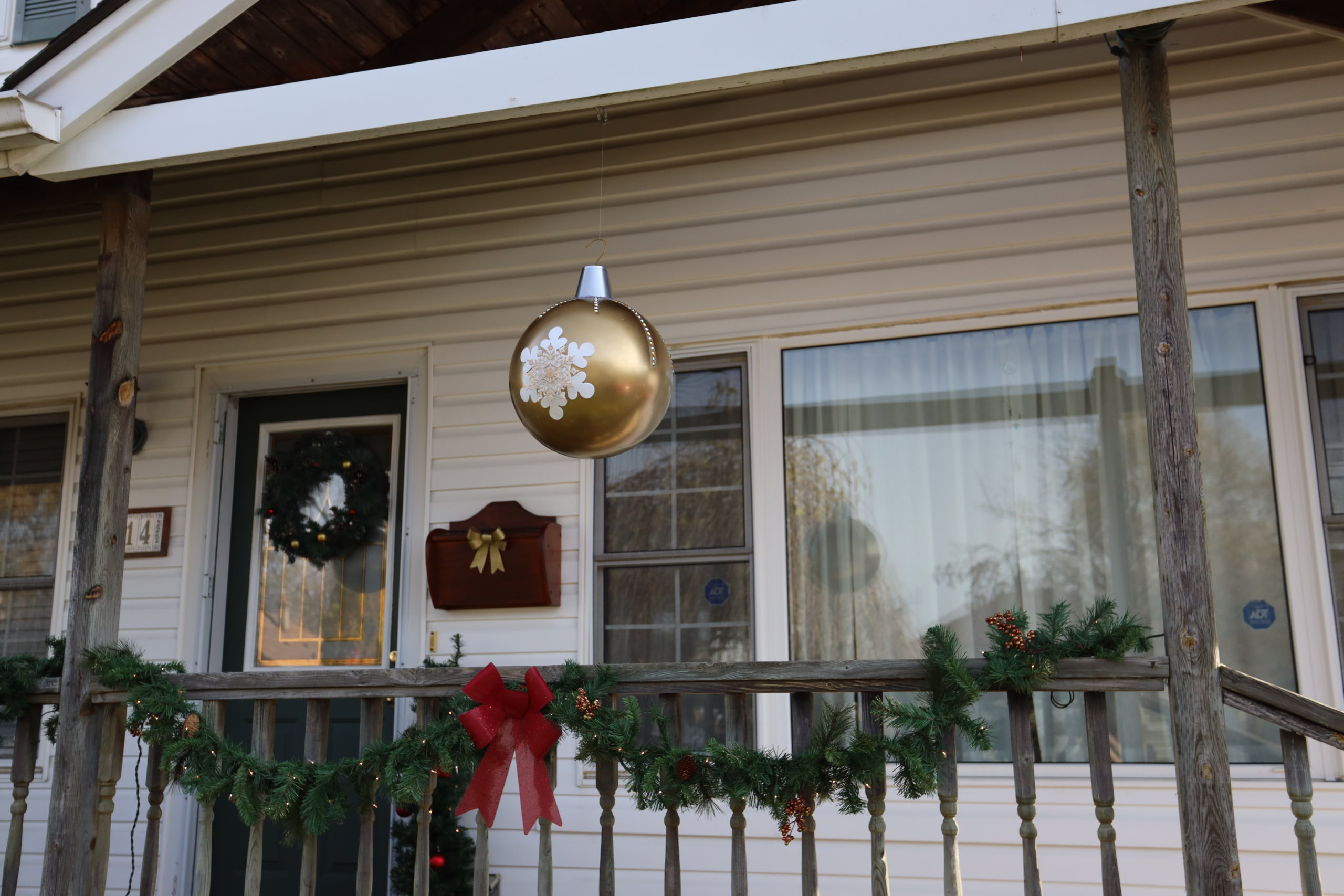 gold ornament ball hanging on porch