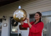 close up of jess with hanging diy ornament ball