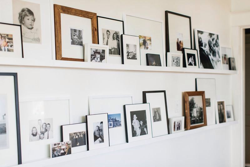 a gallery wall displayed on ledges rather than hung up