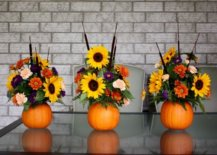 three fall flower arrangements using pumpkins as base