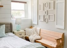 rustic photo gallery wall that is made of just frames