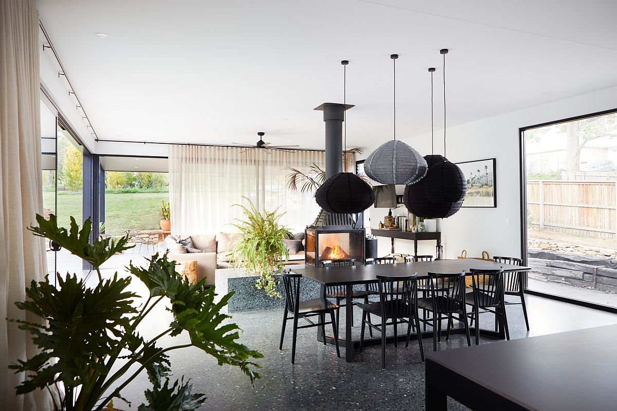 Amazing modern fireplace can be enjoyed from every corner of the room with ease