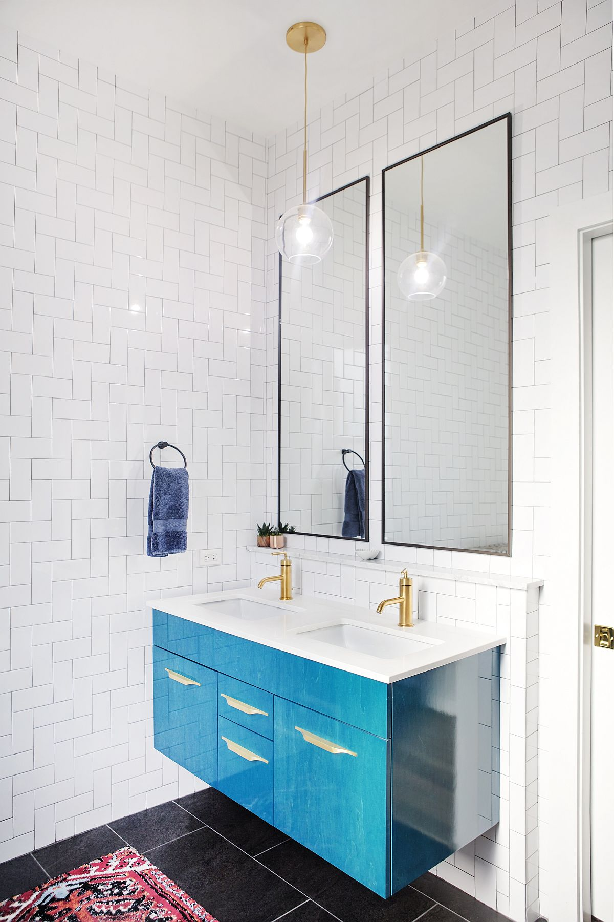 Blue vanity for the bathroom adds color and contrast to the space