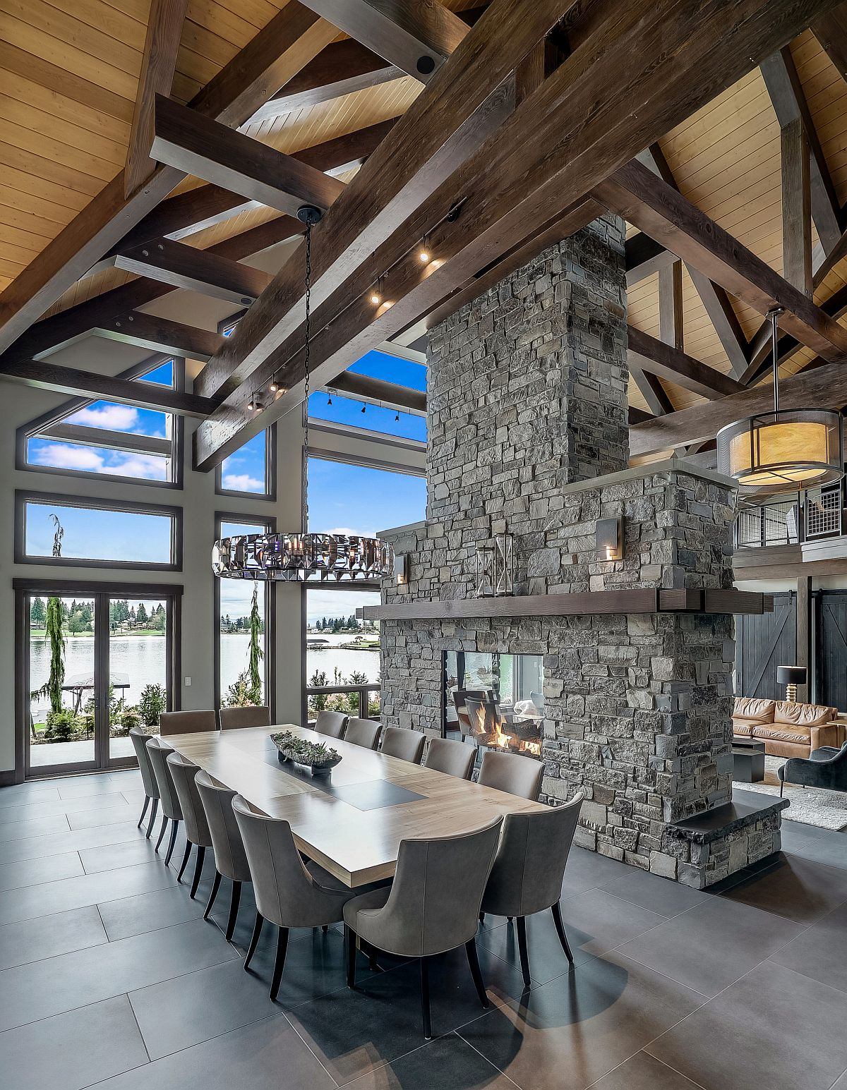Breathtaking two-sided fireplace in stone for the rustic interior