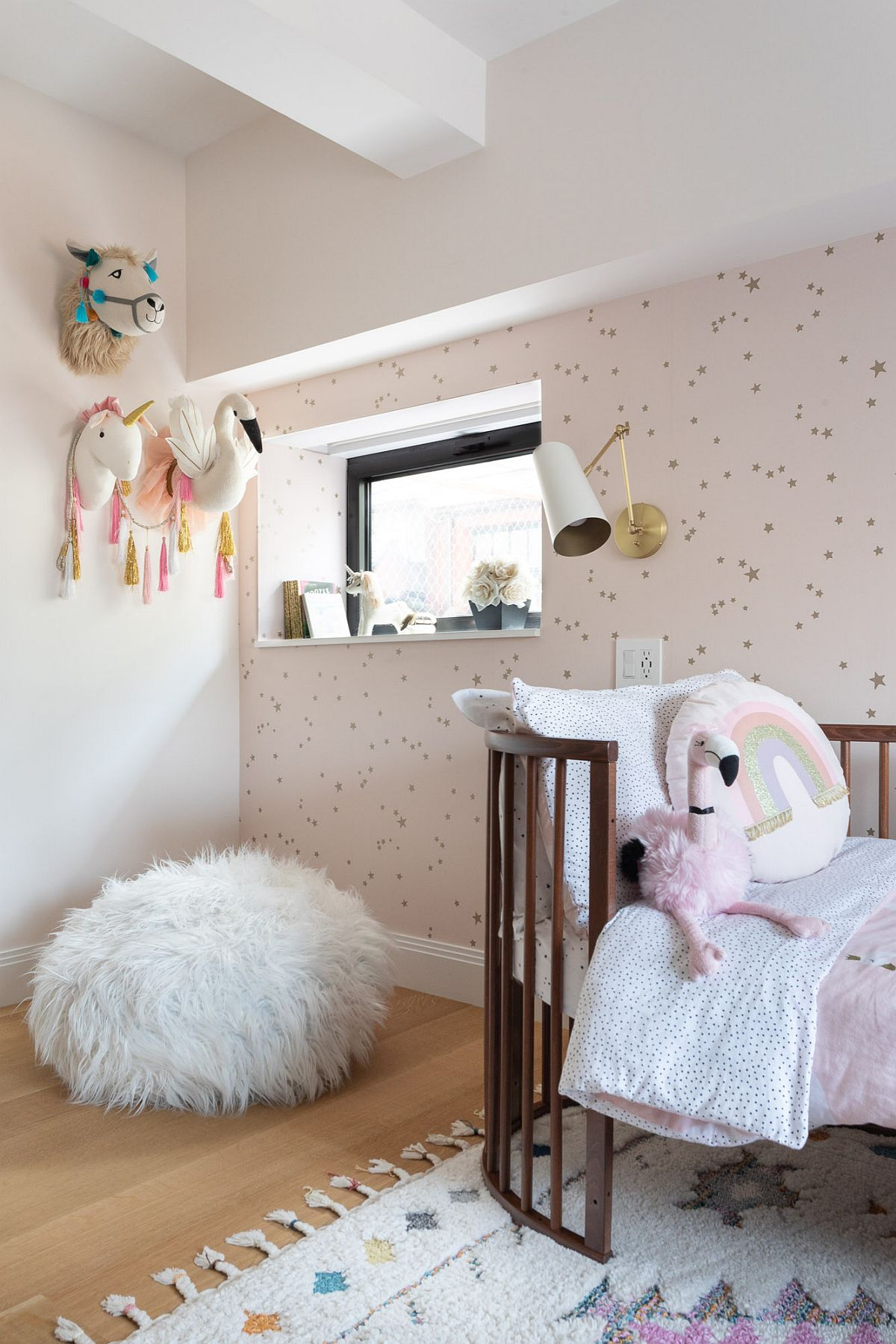 Chic kids' berdoom of New York home with elegant wallpaper and a dash of muted pink