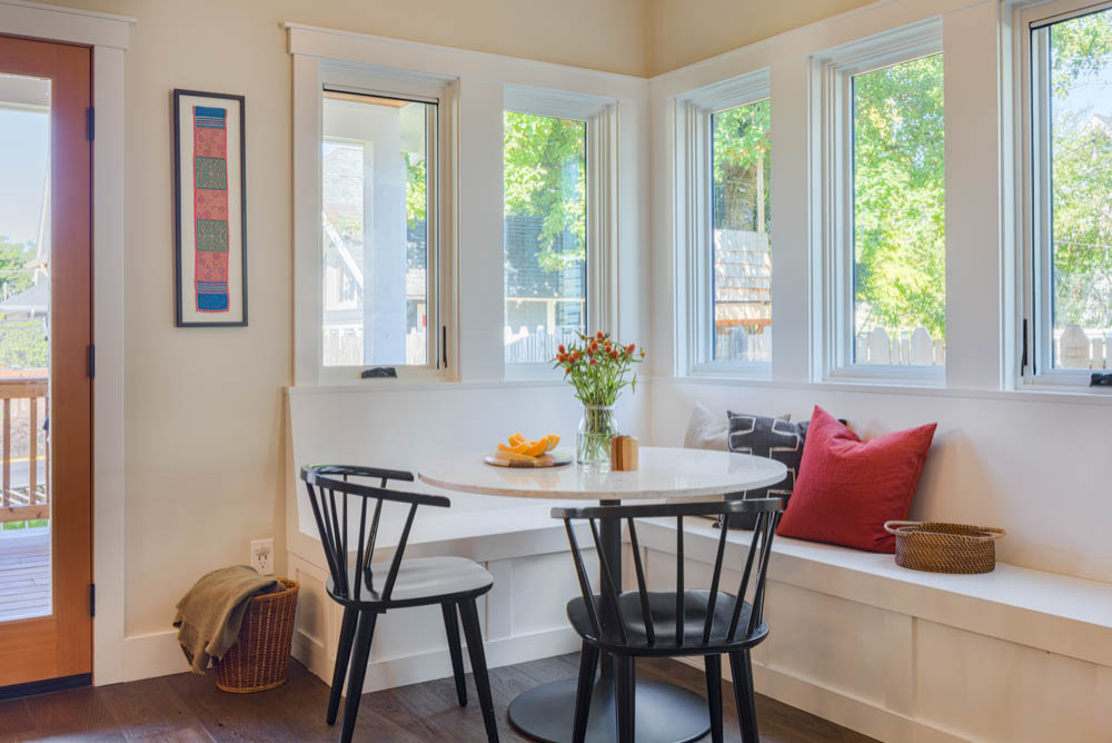 Combine the bench in the corner with chairs for a comfy breakfast zone
