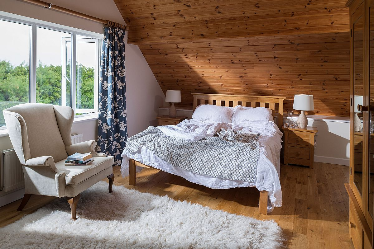 Combine woodsy charm of cabin style with coastal elegance in the bedroom