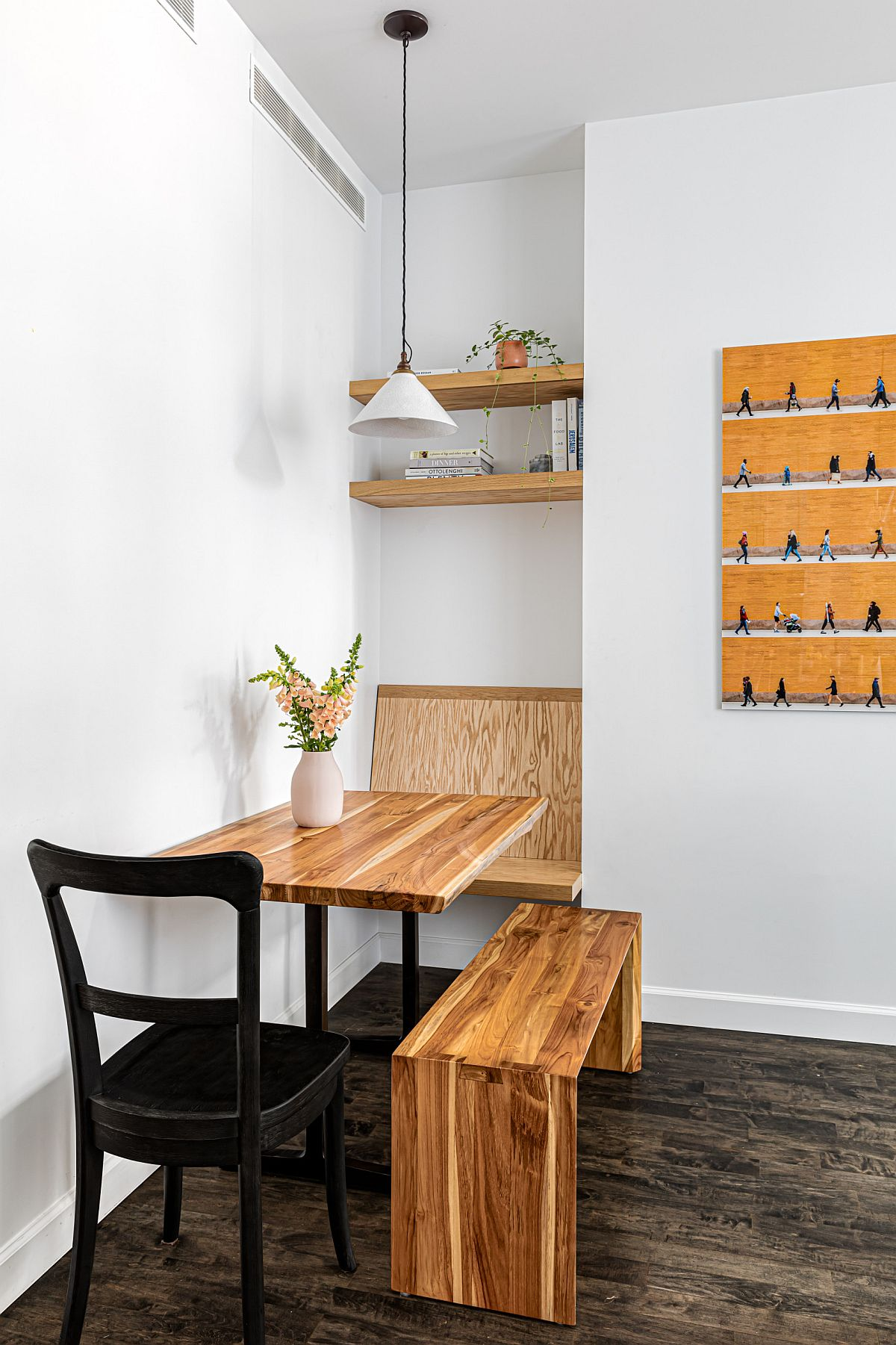 Custom dining space and breakfast zone with wooden table and bench for the modern New York apartment