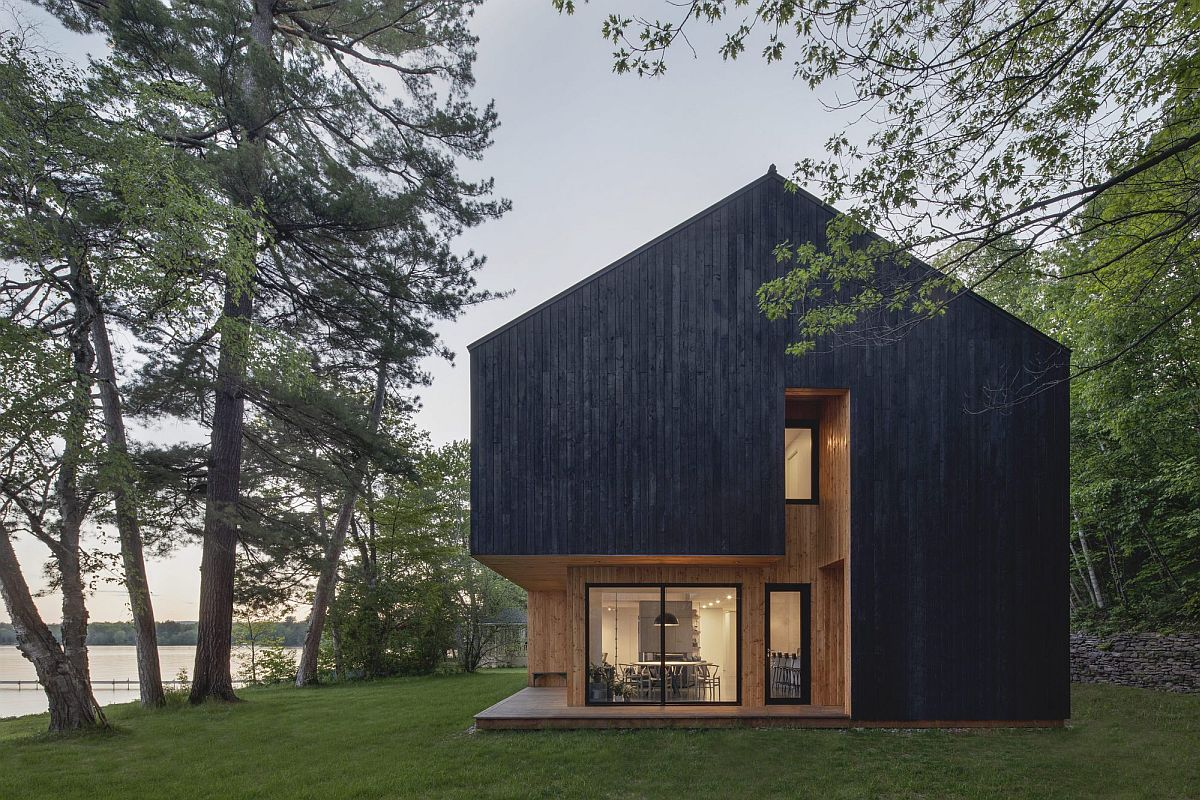 Dark treated larch exterior of the Lakeside Cabin in Canada with lovely lake views