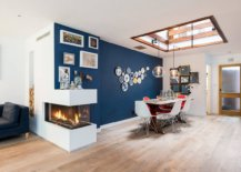 Delightful-blue-accent-wall-skylight-and-a-double-sided-fireplace-brighten-this-dining-room-57176-217x155