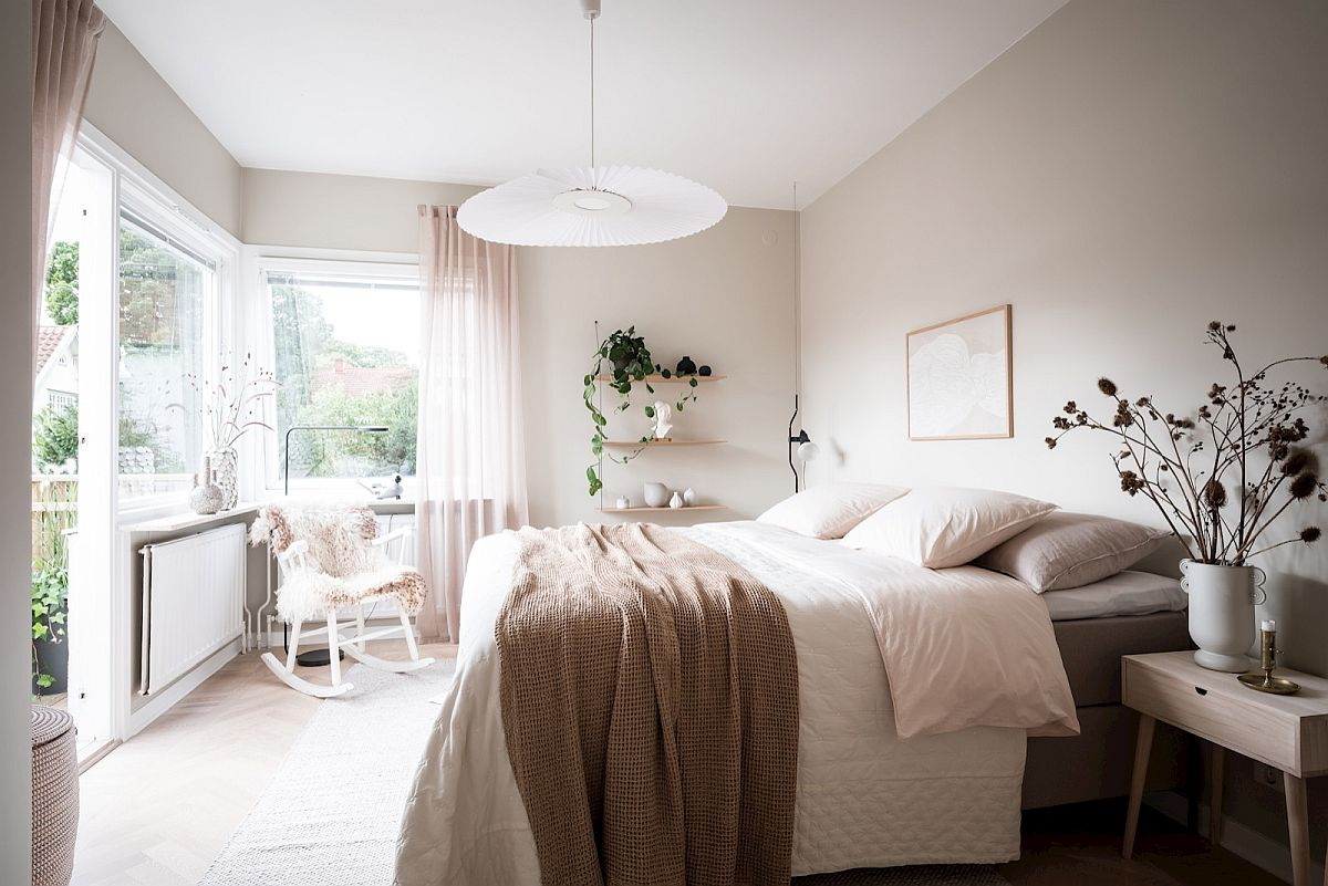 Explore shades other than white in the bedroom that are neutral and yet add something special