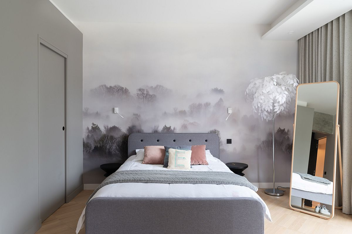 Fabulous mural in the backdrop steals the show in this lovely little Scandinavian style bedroom with gray bed and drapes