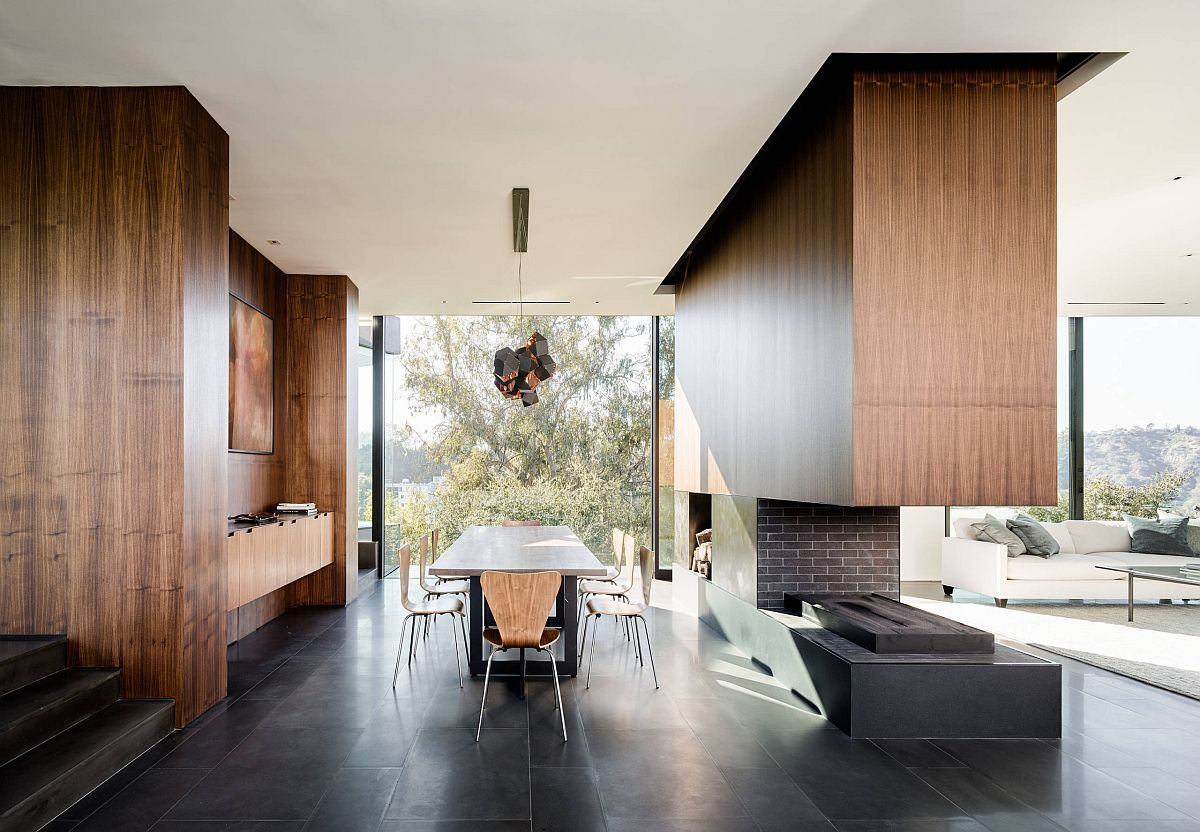Fireplace brings oak elegance and beauty to this dashing, dark dining room