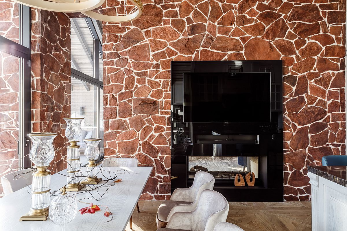 Gorgeous two-sided fireplace fits into the wall beautifully while illuminating both the kitchen and dining space